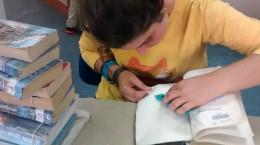 image: Volunteer repairs a book